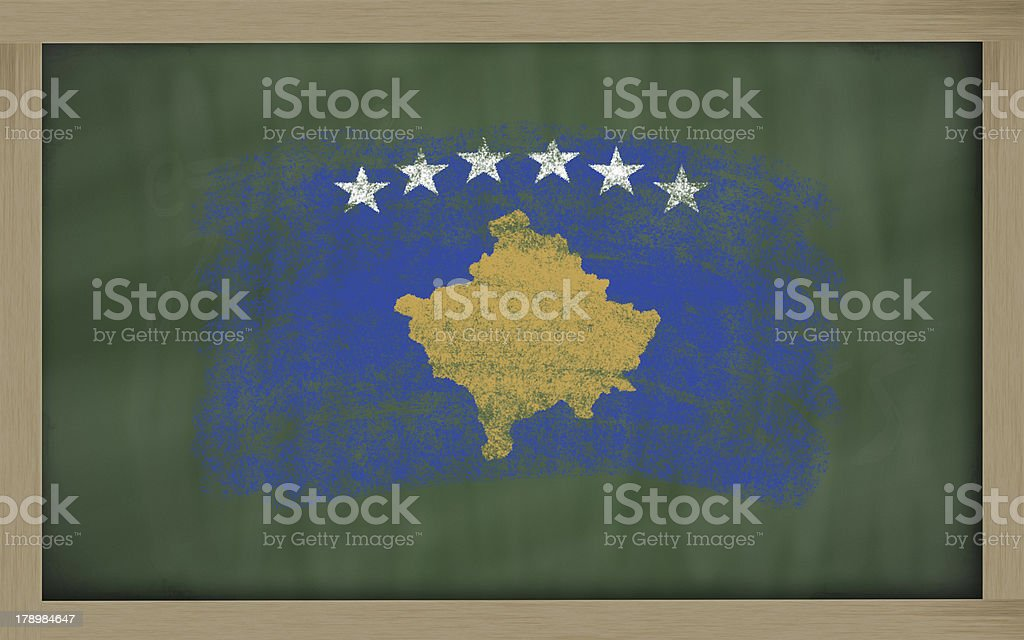 flag of kosovo on blackboard painted with chalk royalty-free stock photo