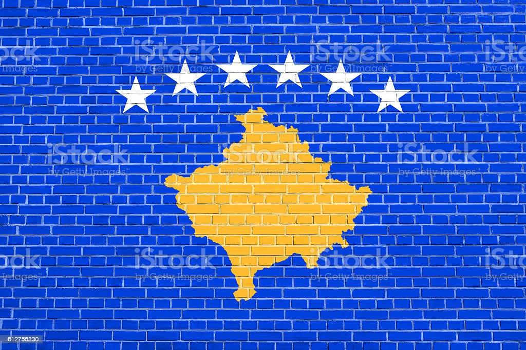 Flag of Kosovo on brick wall texture background stock photo