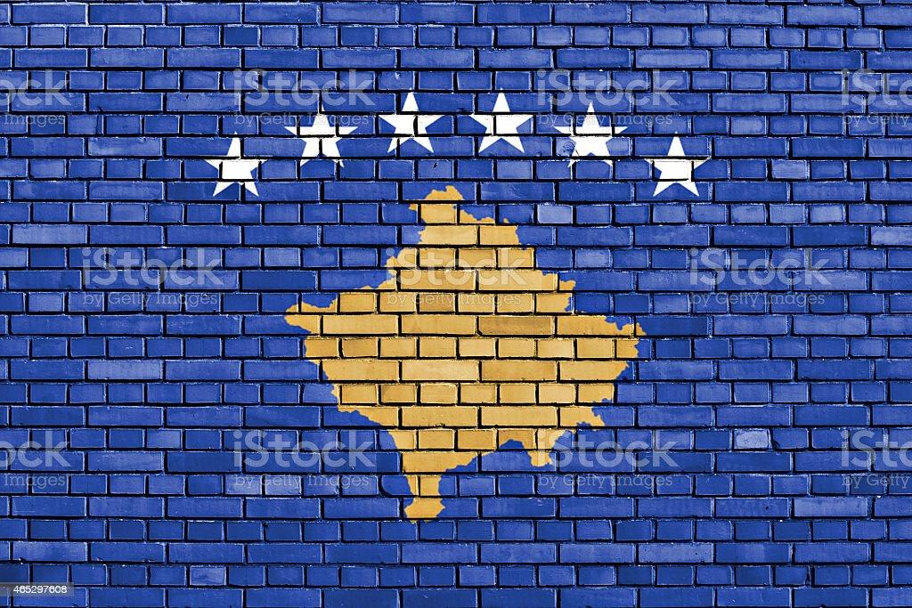 flag of Kosovo painted on brick wall stock photo