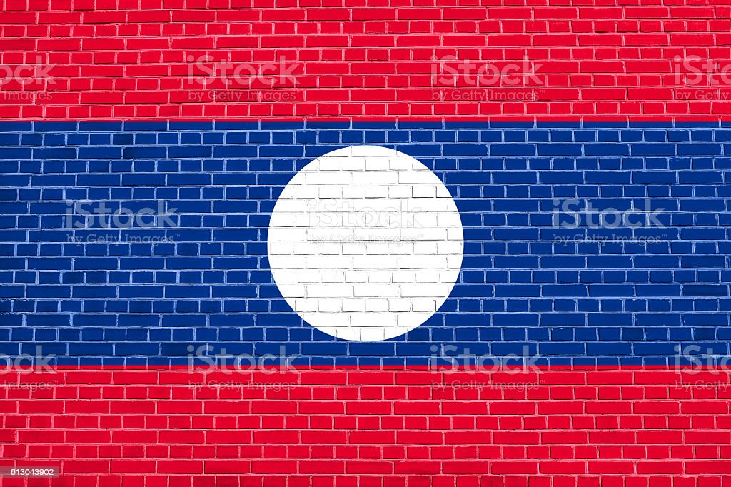 Flag of Laos on brick wall texture background stock photo