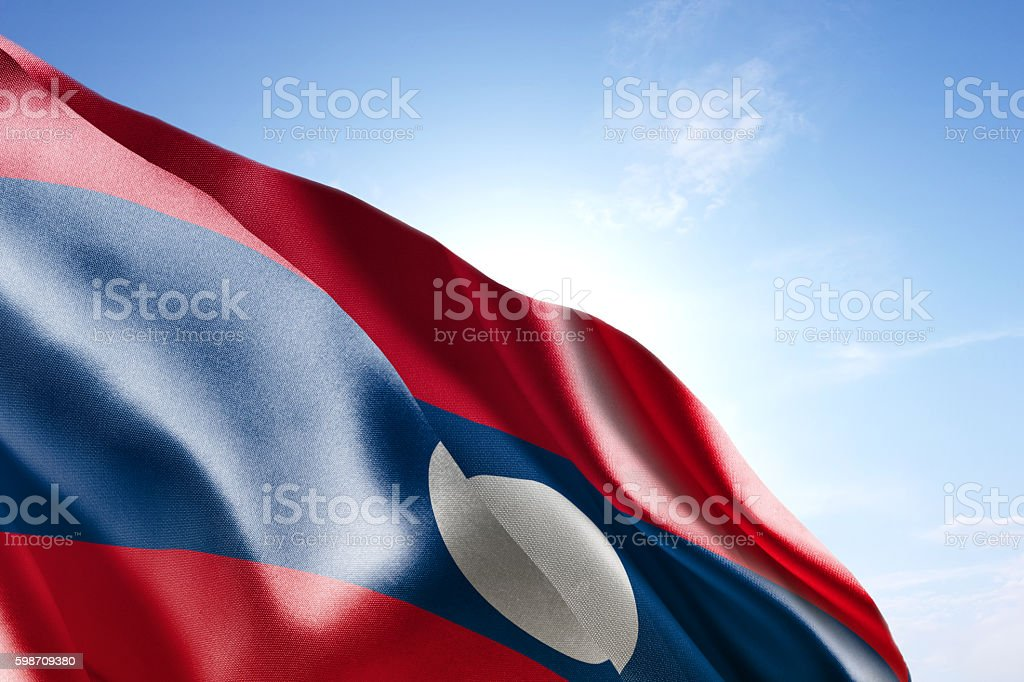 Flag of Laos waving in the wind stock photo