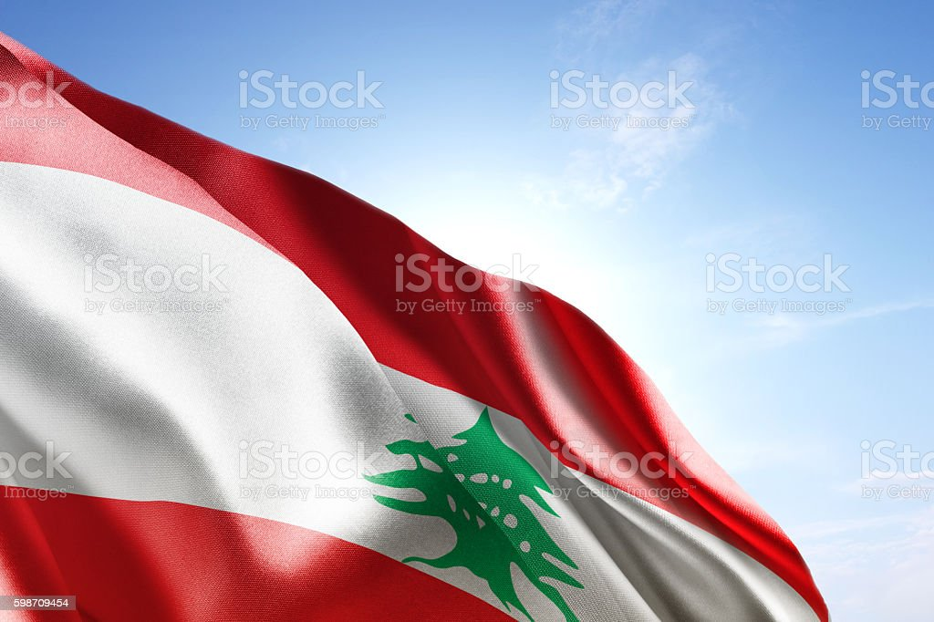 Flag of Lebanon waving in the wind stock photo