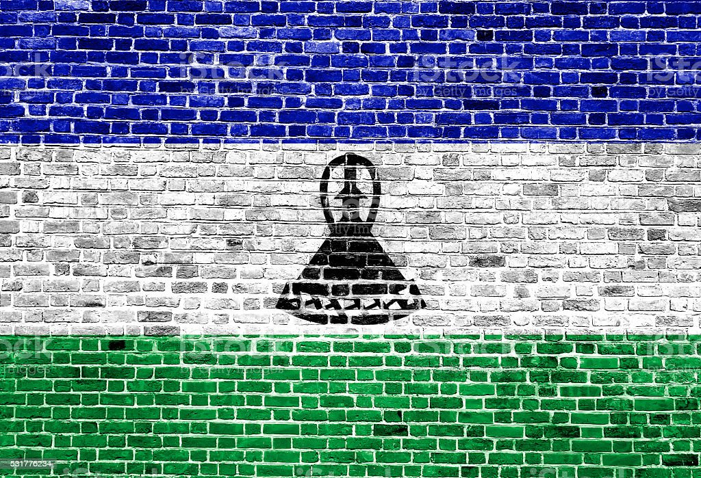 Flag of Lesotho painted on brick wall, background texture stock photo