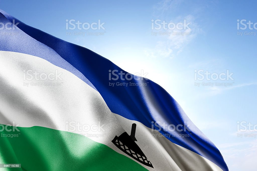 Flag of Lesotho waving in the wind stock photo