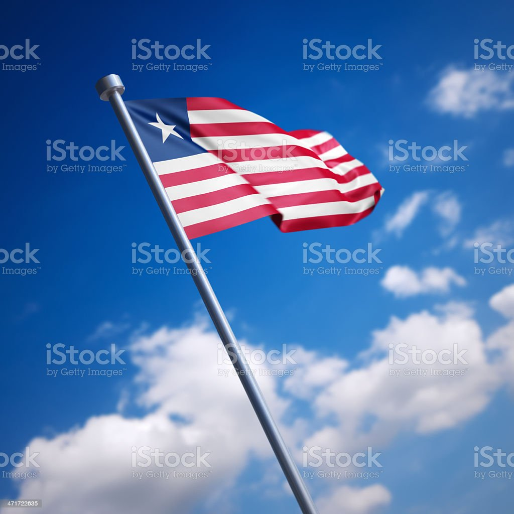 Flag of Liberia against blue sky stock photo