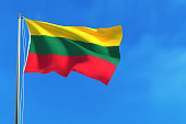 Flag of Lithuania on the blue sky background.