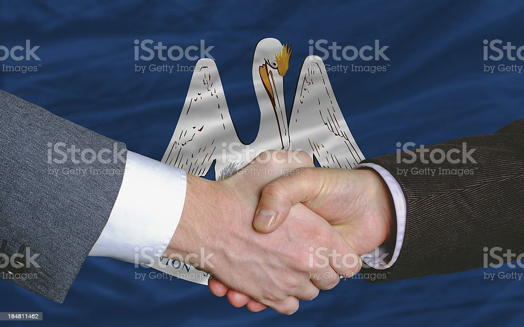 flag of louisiana two businessmen handshake stock photo