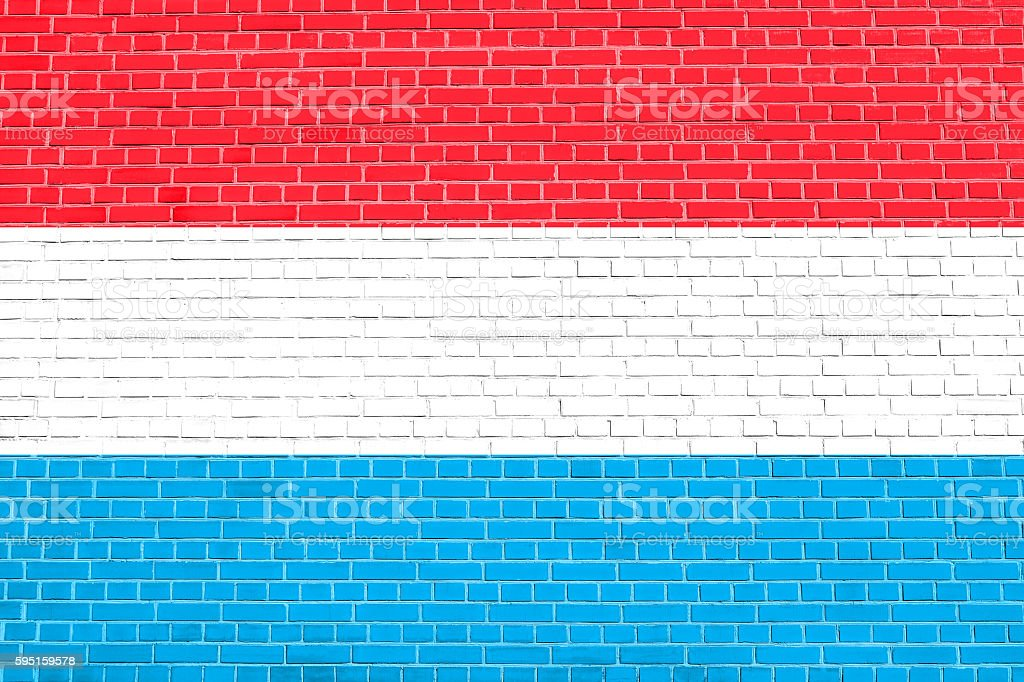 Flag of Luxembourg on brick wall background stock photo