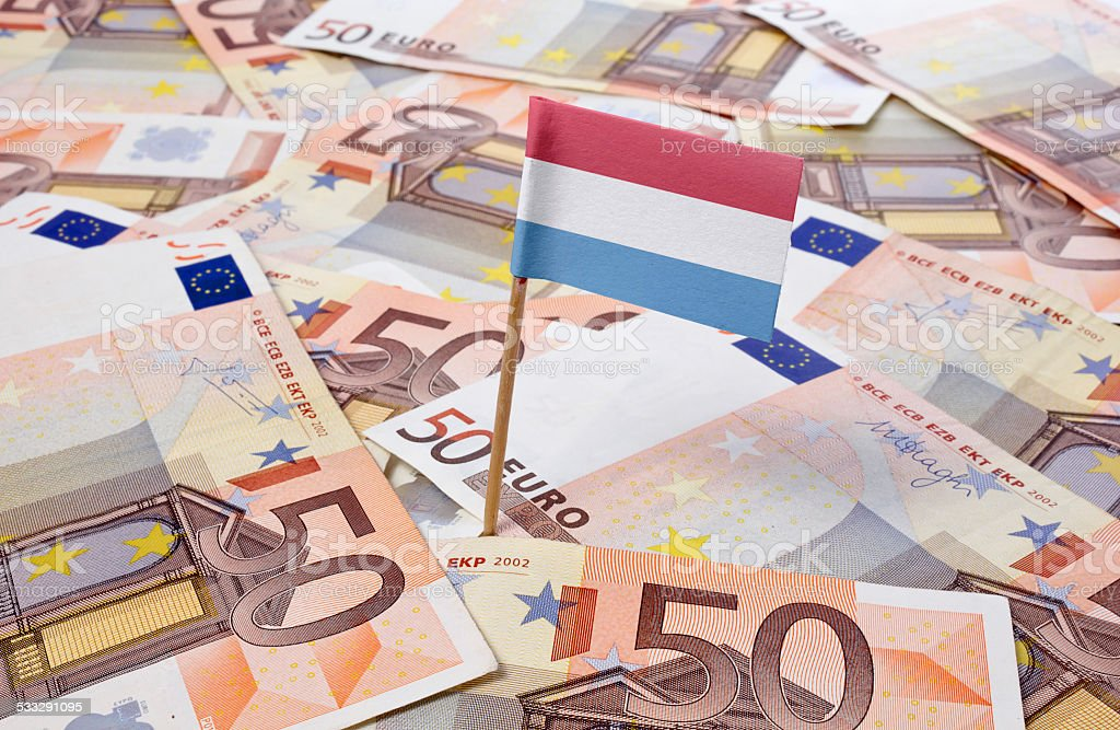 Flag of Luxembourg sticking in 50 Euro banknotes.(series) stock photo
