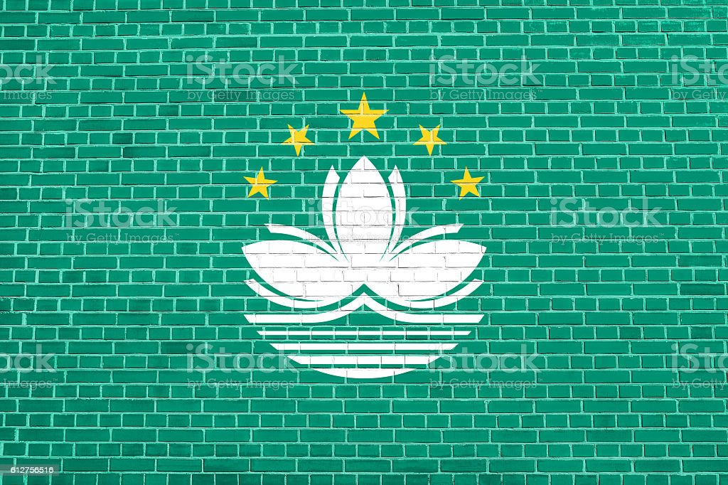 Flag of Macau on brick wall texture background stock photo
