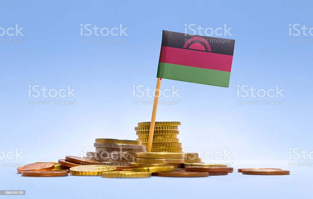 Flag of Malawi in a stack of coins.(series) stock photo
