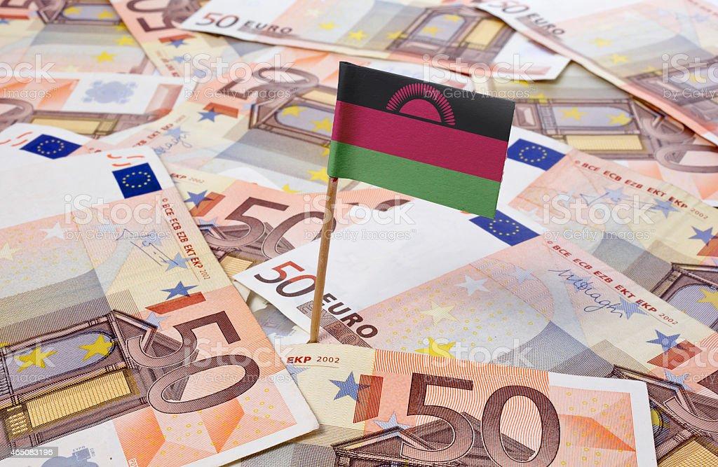 Flag of Malawi sticking in 50 Euro banknotes.(series) stock photo
