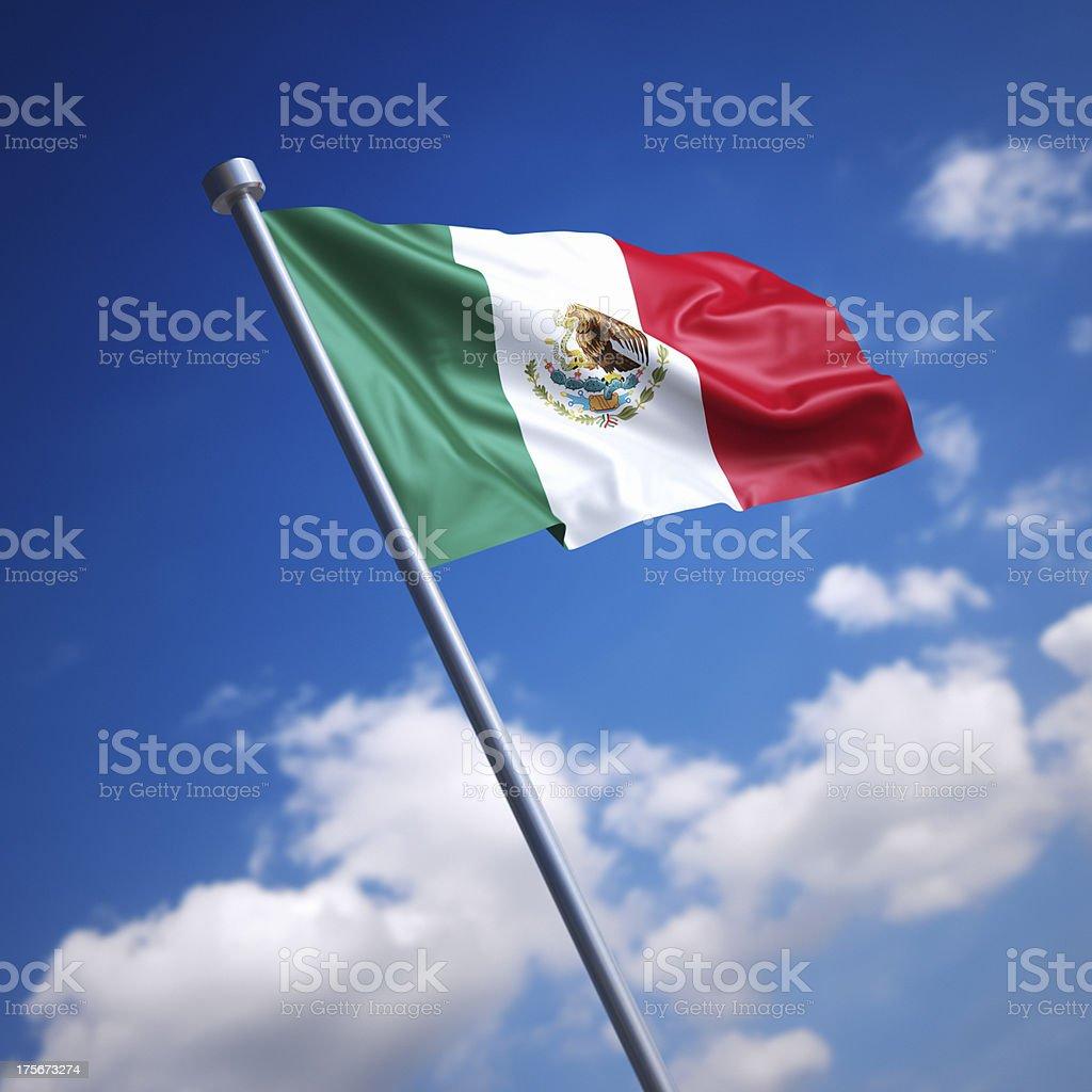 Flag of Mexico against blue sky stock photo