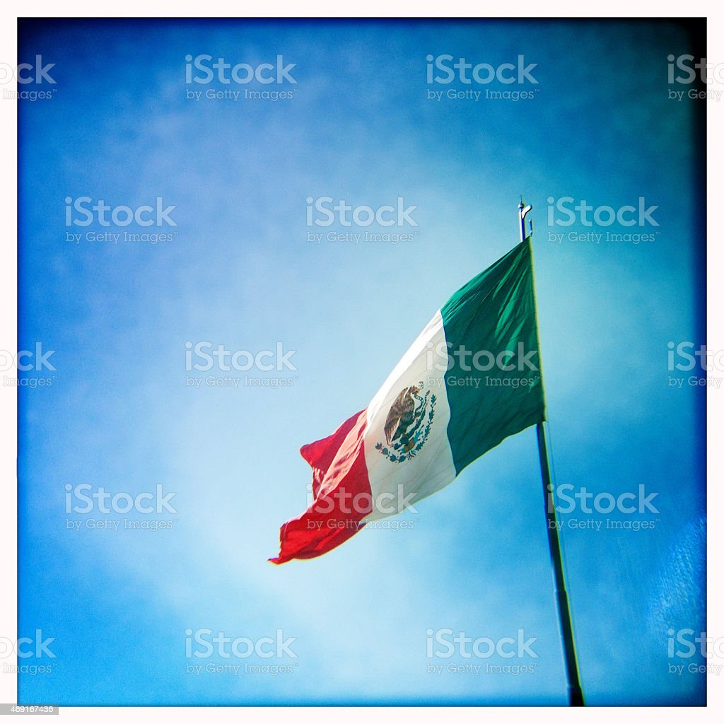Flag of Mexico with blue sky stock photo