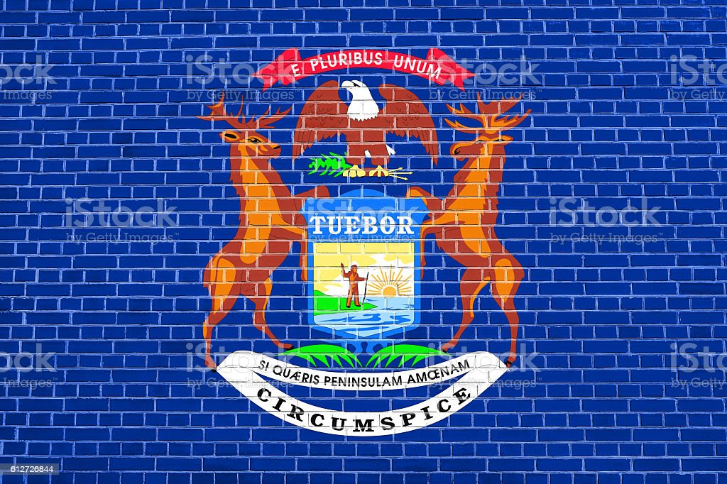 Flag of Michigan on brick wall texture background stock photo