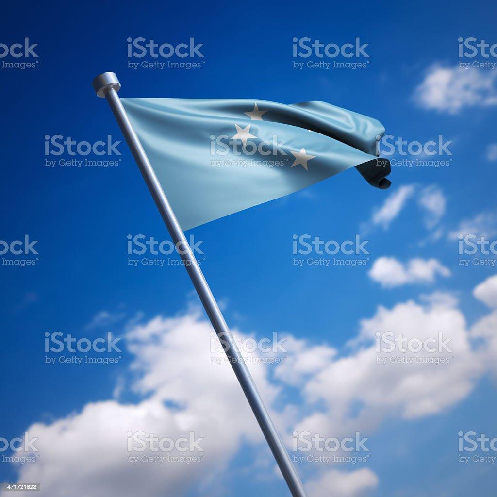 Flag of Micronesia against blue sky stock photo