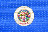 Flag of Minnesota on brick wall texture background