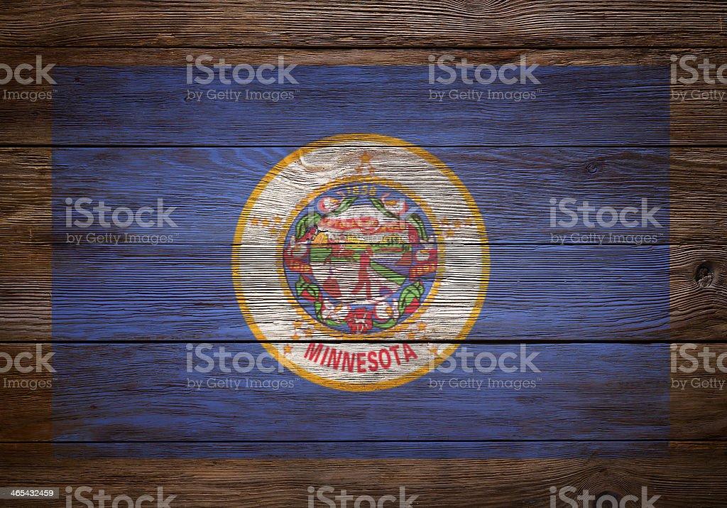 Flag of Minnesota stenciled on wood stock photo
