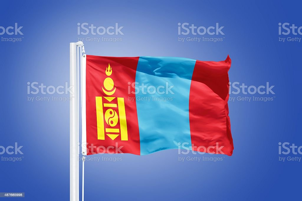 Flag of Mongolia flying against a blue sky stock photo