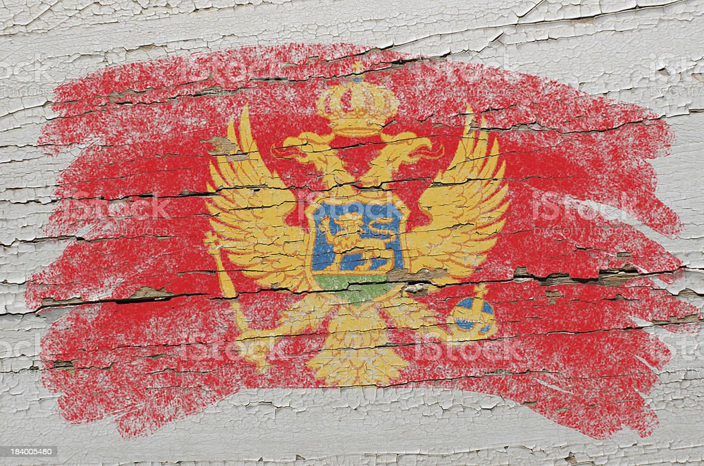 flag of montenegro on grunge wooden texture painted with chalk royalty-free stock photo