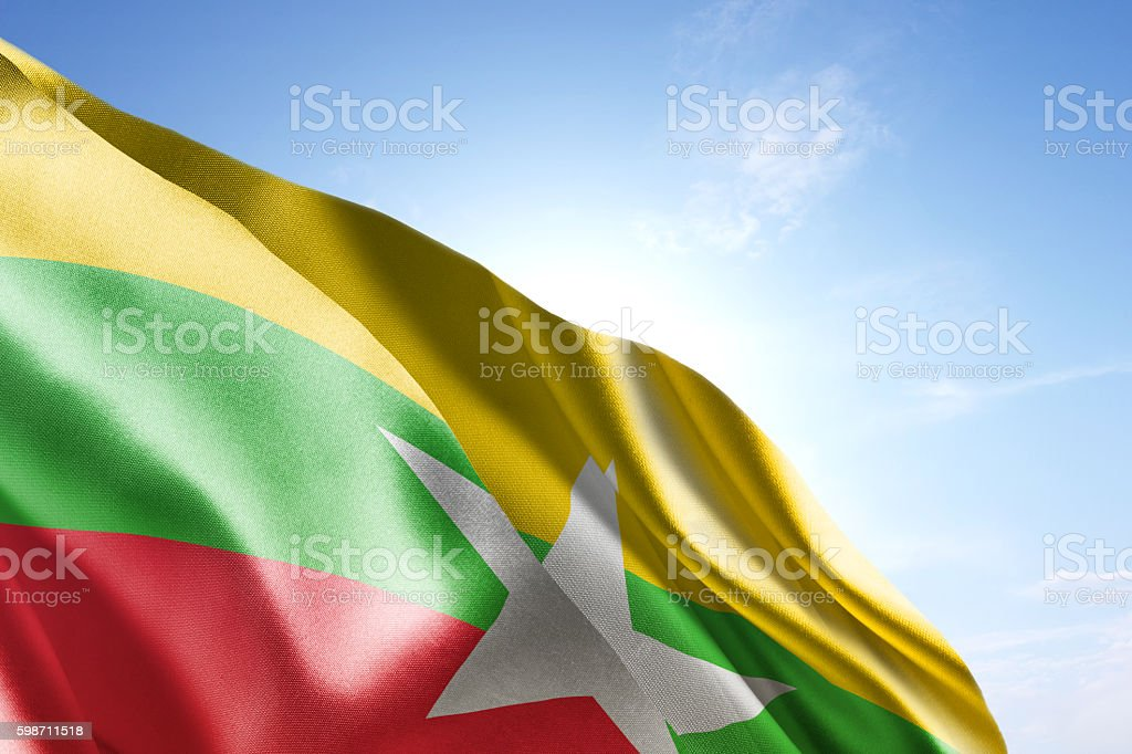 Flag of Myanmar waving in the wind stock photo
