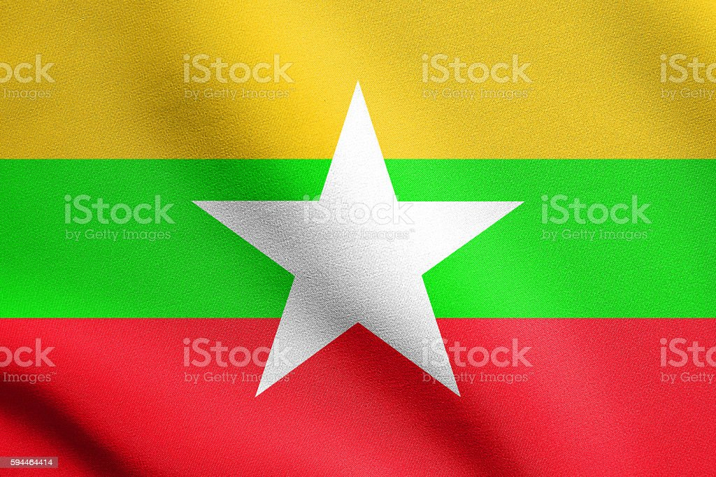 Flag of Myanmar waving in wind with fabric texture stock photo