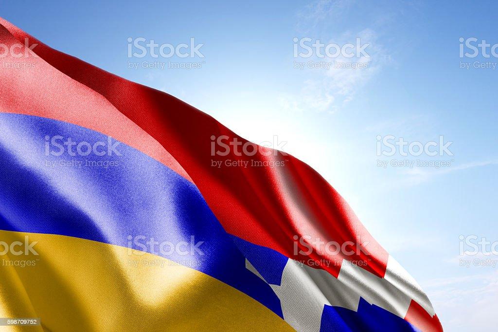 Flag of Nagorno-Karabakh waving in the wind stock photo