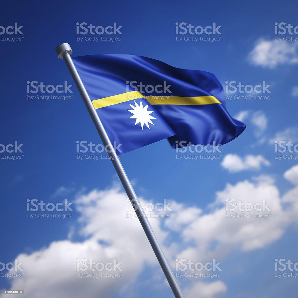 Flag of Nauru against blue sky stock photo