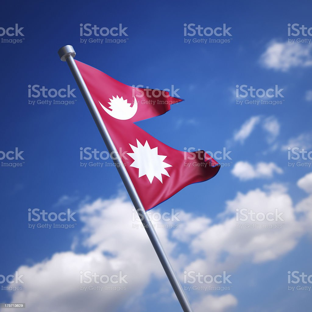Flag of Nepal isolated against blue sky stock photo