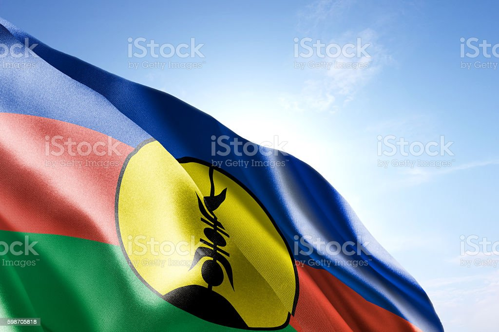 Flag of New Caledonia waving in the wind stock photo