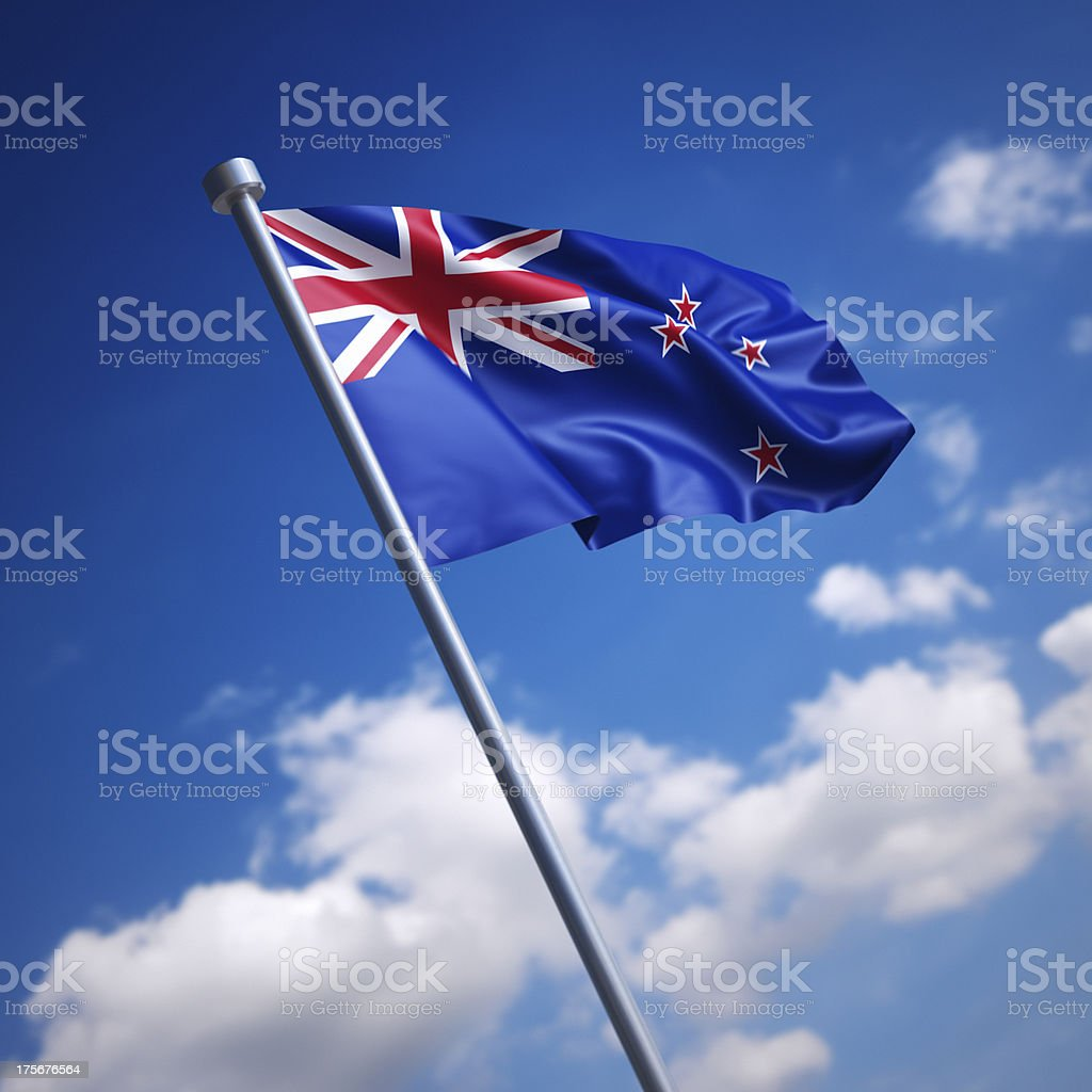 Flag of New Zealand against blue sky stock photo