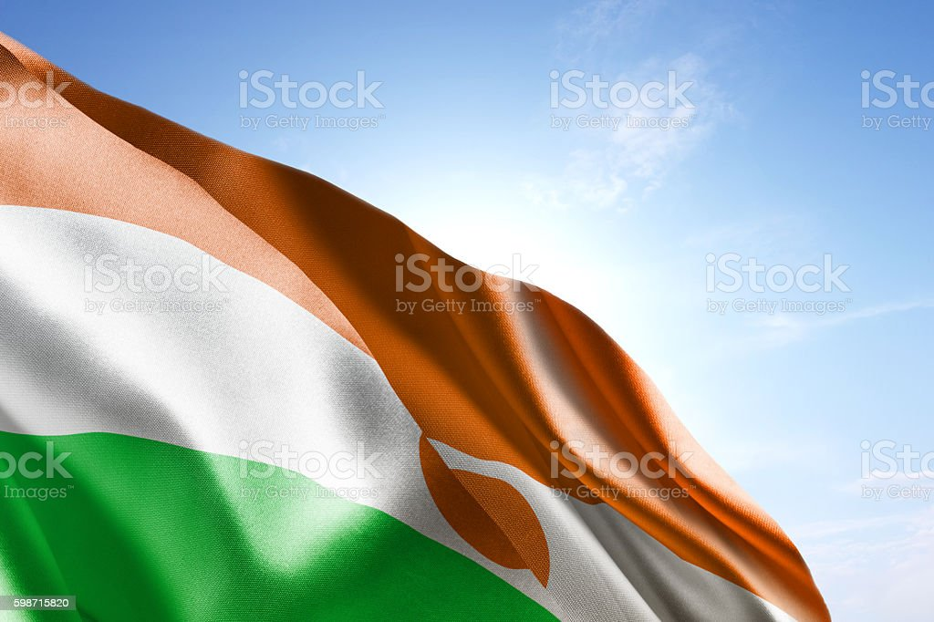 Flag of Niger waving in the wind stock photo