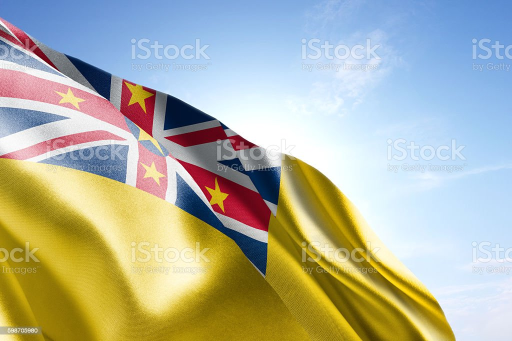 Flag of Niue waving in the wind stock photo
