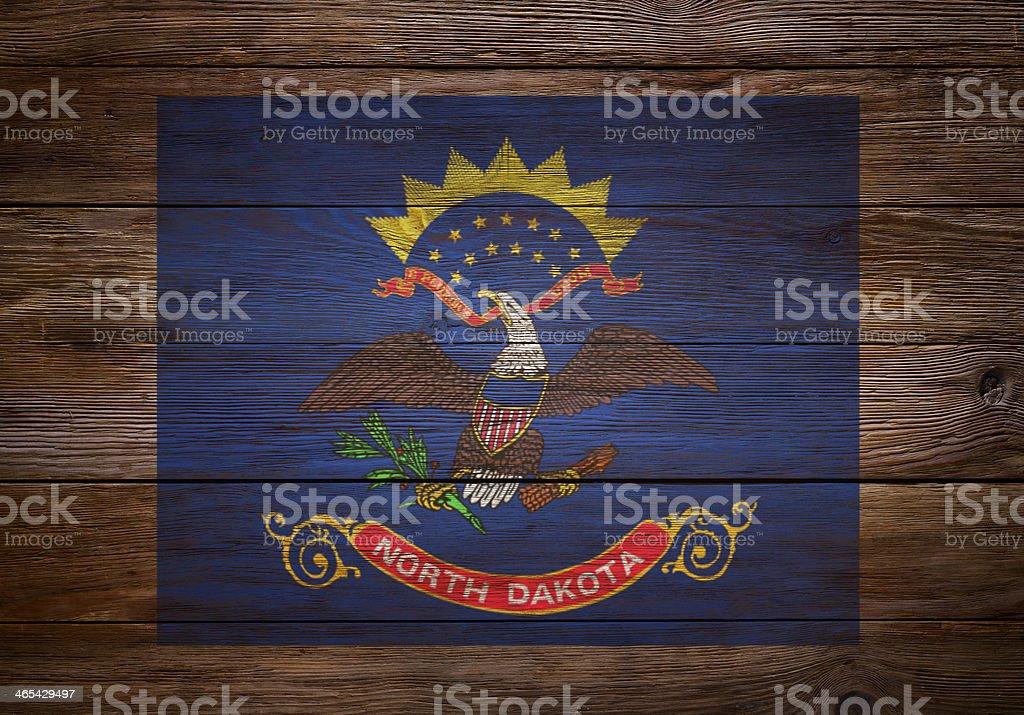 Flag of  North Dakota stenciled on wood royalty-free stock photo
