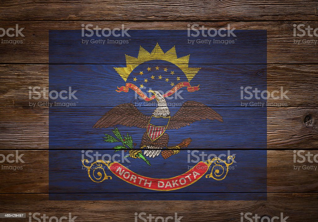 Flag of  North Dakota stenciled on wood stock photo