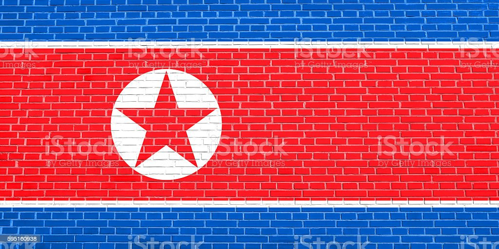 Flag of North Korea on brick wall texture background stock photo