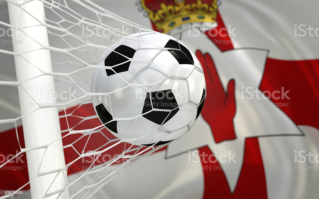 Flag of Northern Ireland and soccer ball in goal net royalty-free stock photo