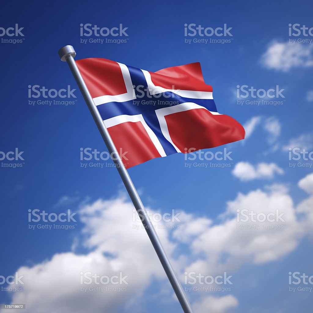 Flag of Norway against blue sky stock photo