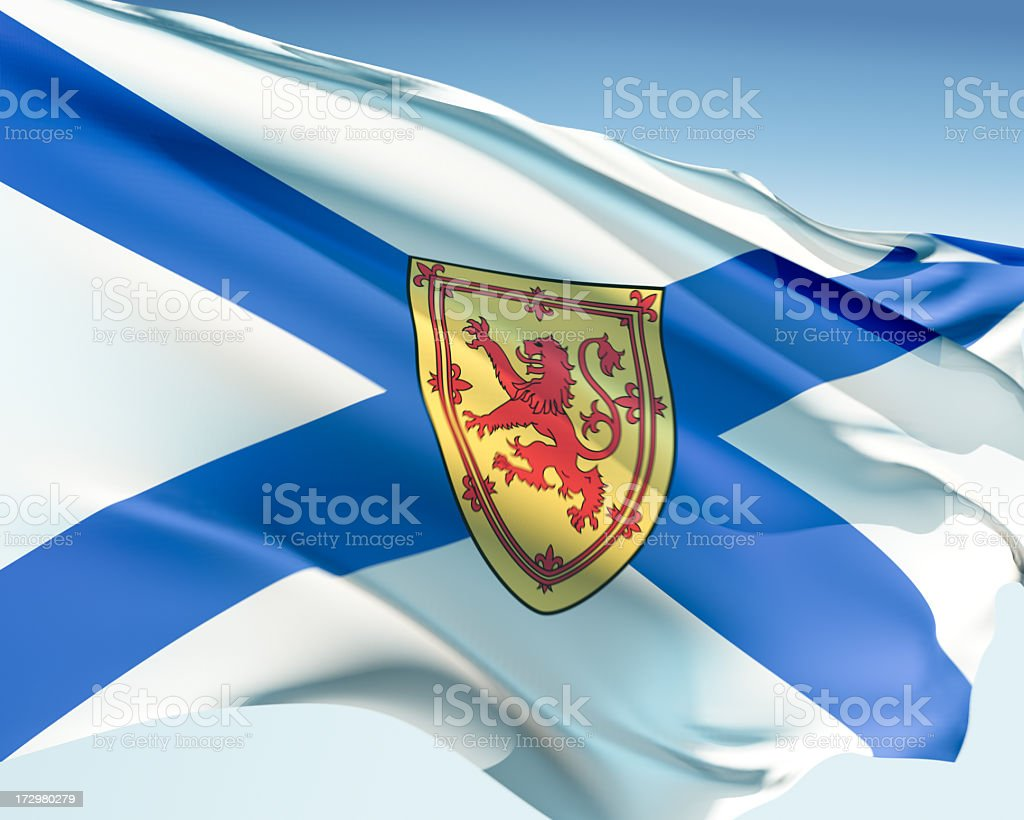 A flag of Nova Scotia waving in the blue sky stock photo