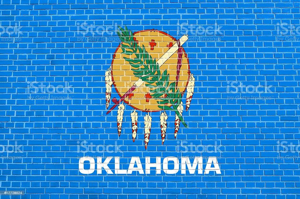 Flag of Oklahoma on brick wall texture background stock photo