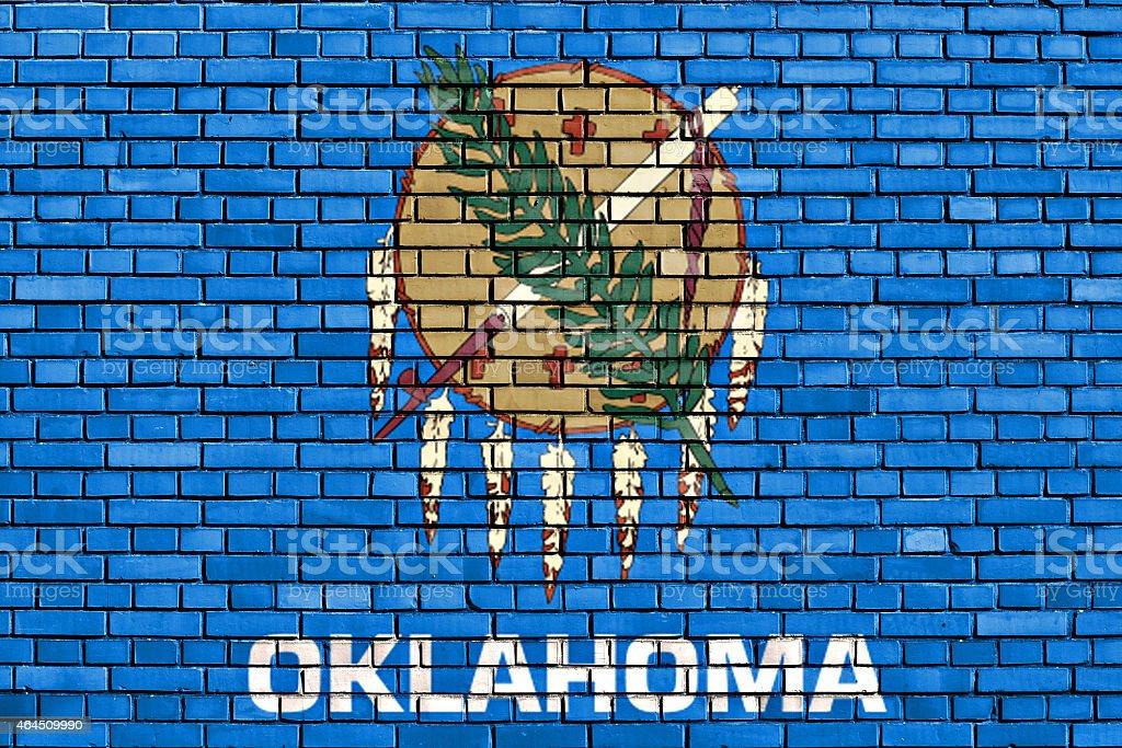 flag of Oklahoma painted on brick wall stock photo