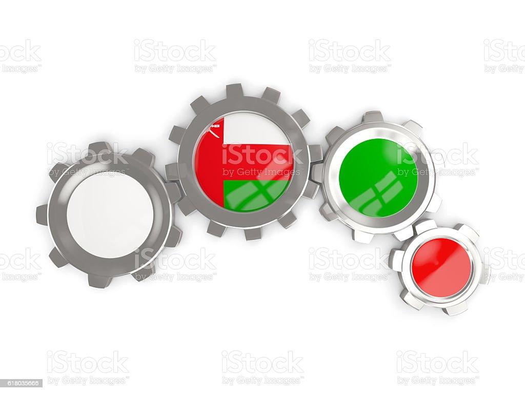 Flag of oman, metallic gears stock photo