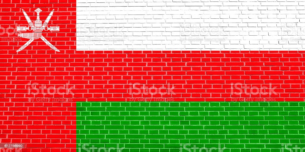Flag of Oman on brick wall texture background stock photo