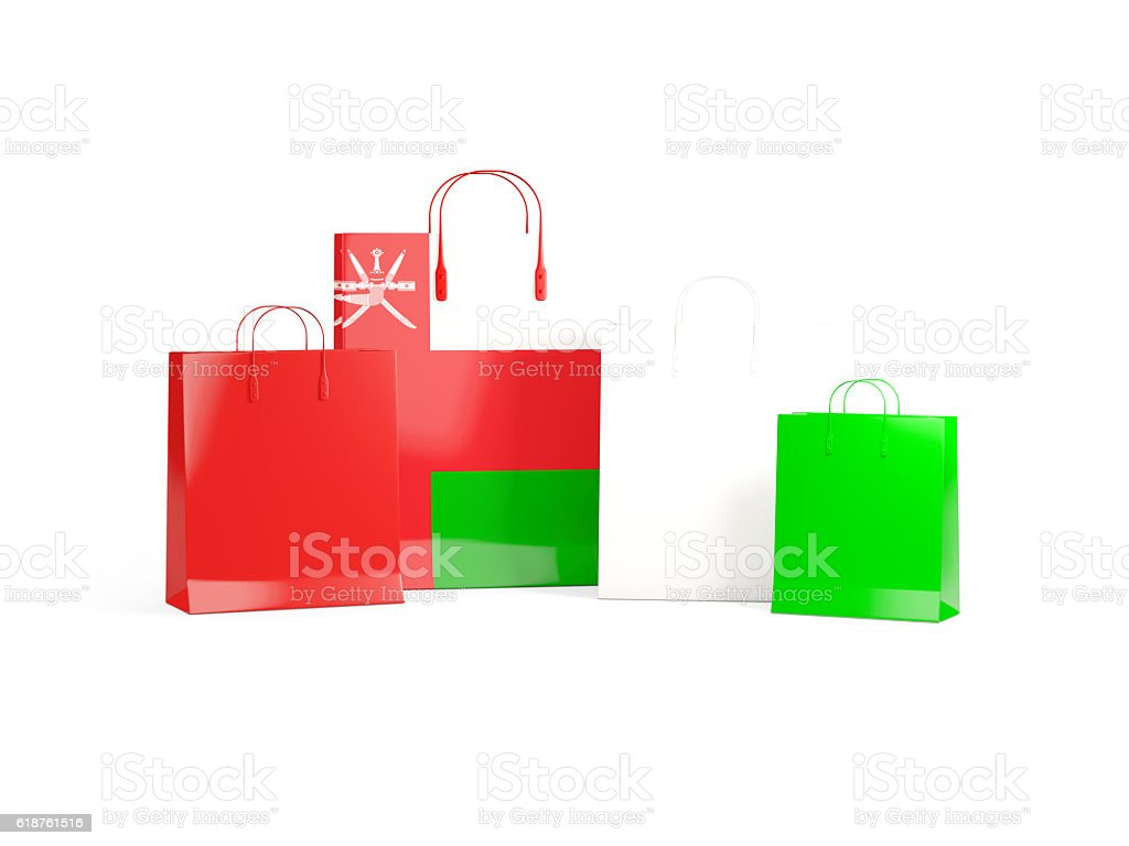 Flag of oman on shopping bags stock photo