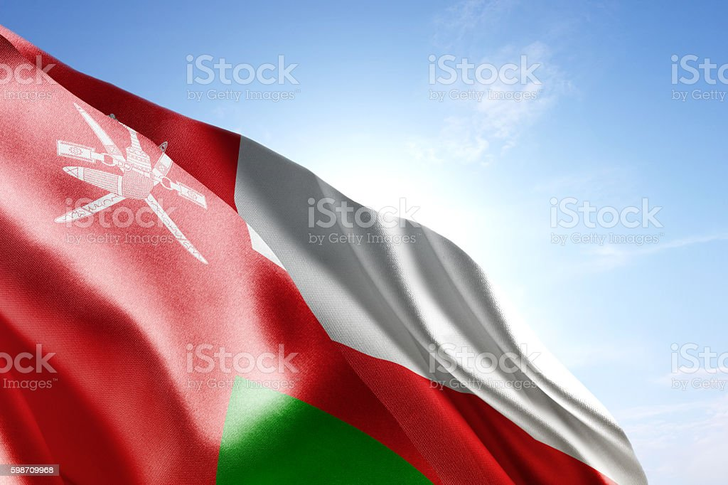 Flag of Oman waving in the wind stock photo