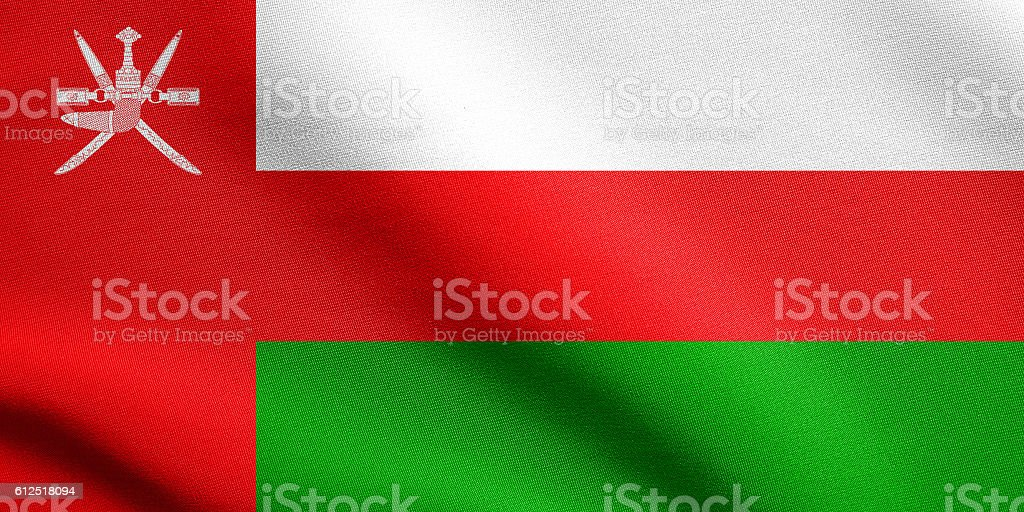 Flag of Oman waving with fabric texture stock photo