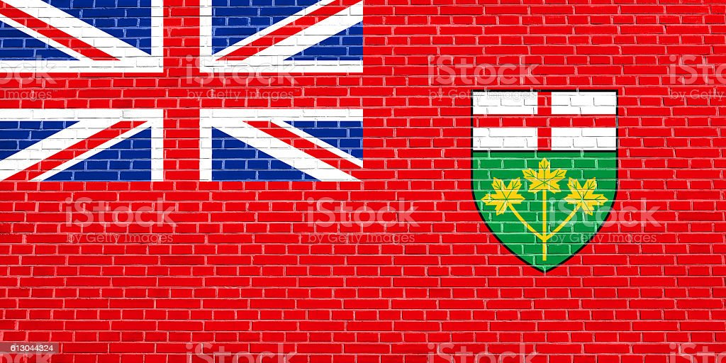 Flag of Ontario on brick wall texture background stock photo