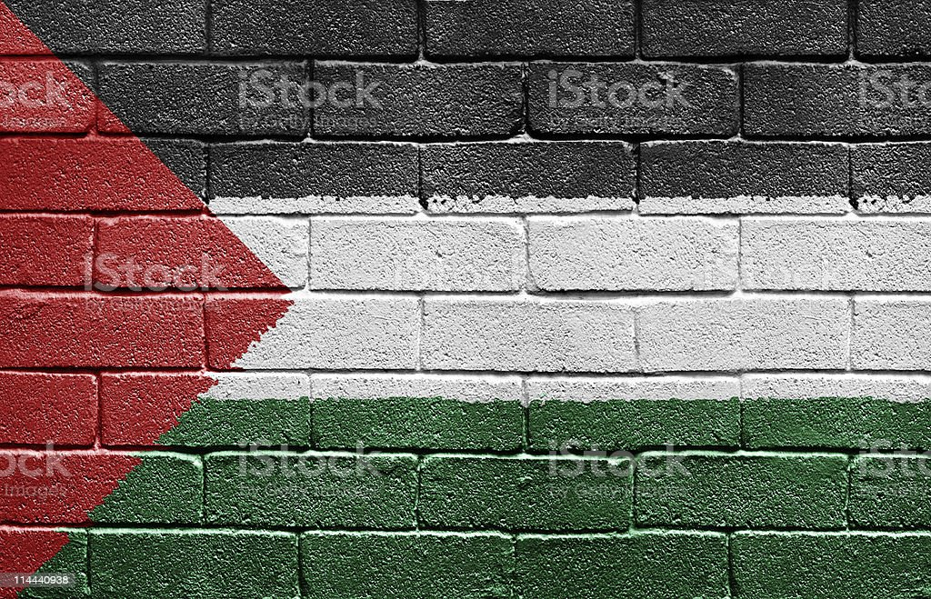 Flag of Palestine on brick wall stock photo