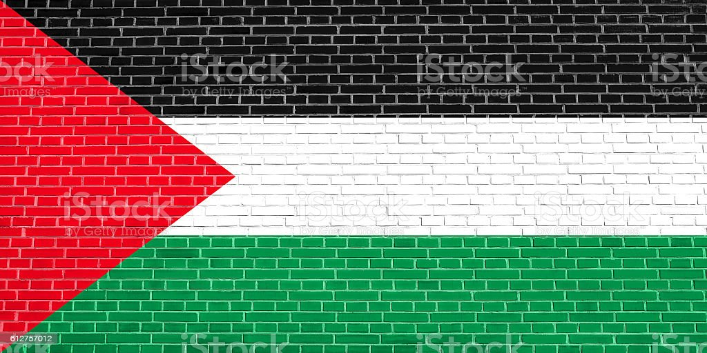 Flag of Palestine on brick wall texture background stock photo