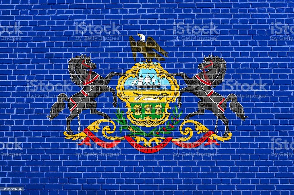 Flag of Pennsylvania brick wall texture background stock photo